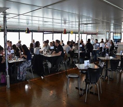People enjoy dining amoung the cruise