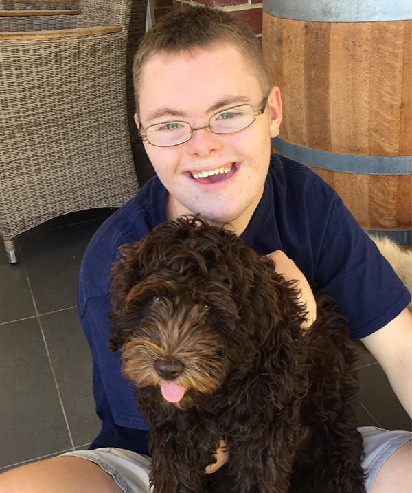 Charlie cuddling a dog